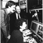 Connick, Hurt, and a technician in the ITV control room, newspaper clipping.