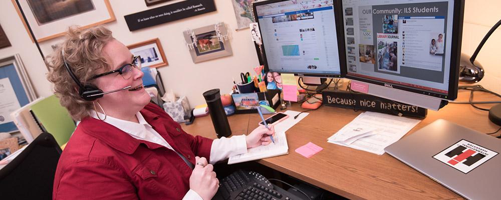 ILS Program Coordinator Jodi Williams chats with ILS online students