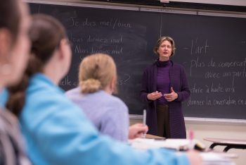 french professor lecturing to classroom of students