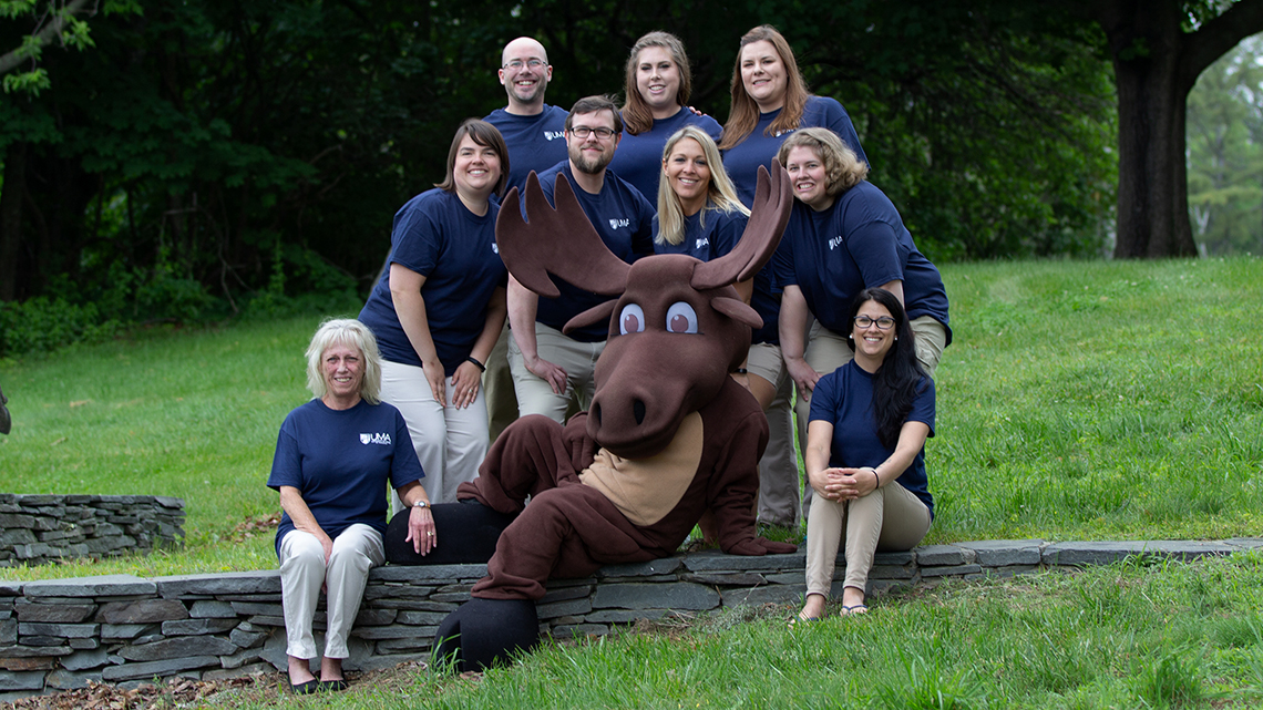 The UMA Admissions team pictured with UMA mascot, Augustus the Moose.