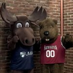 UMA mascot Augustus the Moose poses for a photo with UMF mascot Chompers the beaver.