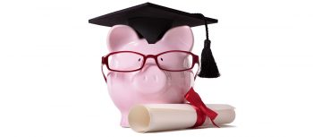 Piggy bank wearing graduation cap.