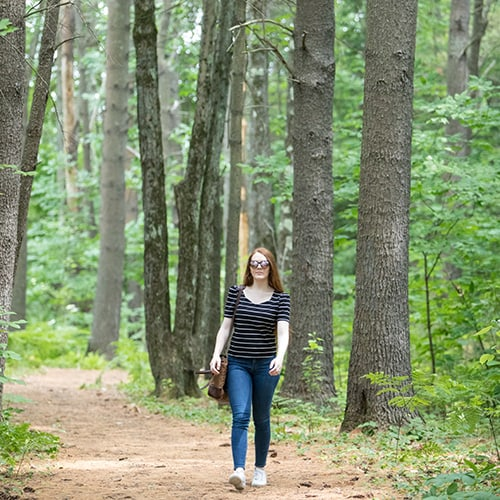 UMA Student Walking in Forest