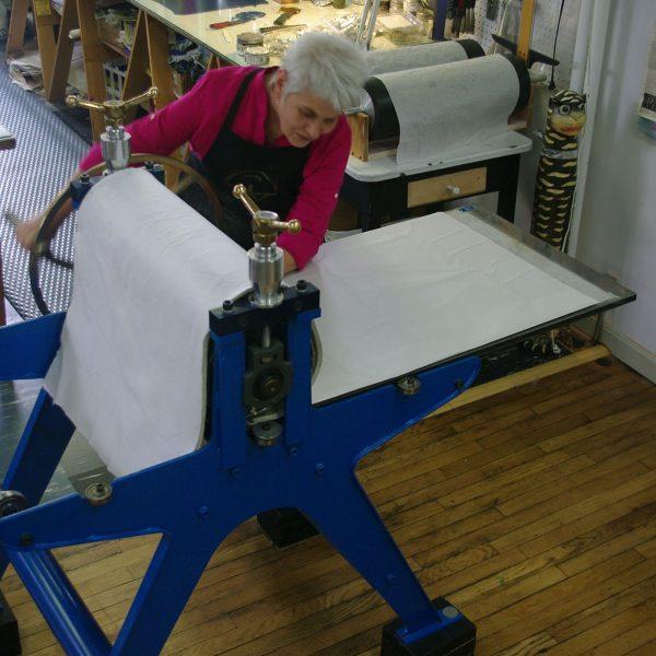 Karen Adrienne working at press.