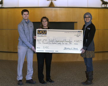 University Credit Union presents checks to University of Maine at Augusta Campus Food Pantries