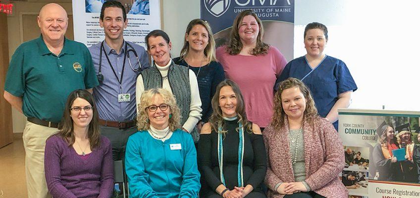 From left to right standing: Niel Nielsen, Dr. Ezra Steinberg, Brenda McAleer, Jocelyn Potthoff, Allison Simpson, Angi Parker. From left to right seated: Jennifer Freese, Margaret Wheeler, Catherine Osterhaudt, Lisa Quinones.