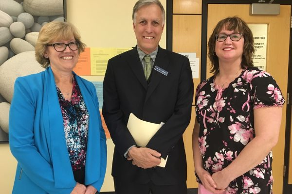 Photo of UMS Chief Student Affairs Officer Rosa Redonnett, Rep Erik Jorgensen and UMA Nursing Student Danielle Doyon at Maine Legislature.