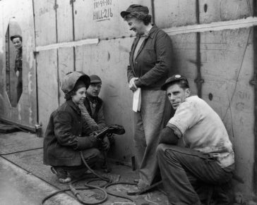 BIW shipbuilding team, 1942, Photo courtesy of Maine Maritime Museum, BIW Collection