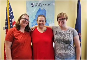 Left to right: Mellissa Meserve, Brenda Plummer, and Carly Meserve. A family photo of three generations taking classes through UMA's Saco Center.