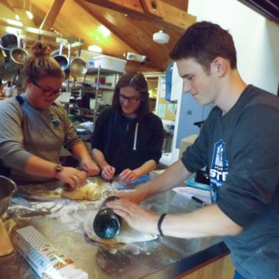 Participants rolling out bread dough fun at the French Immersion weekend.