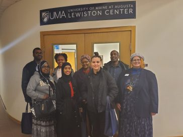 L/A College Transitions students visit UMA's Lewiston Center, pictured here with UMA's Lynn Poor (far right).
