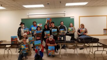 Photo of UMA Lewiston students showing off their completed works of art!