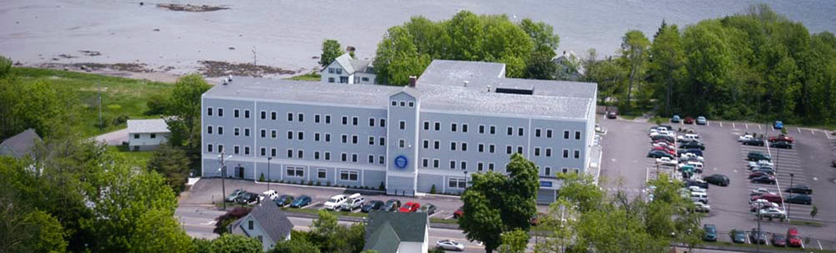 Aerial view of the UMA Rockland Center located inside the Breakwater Building on the coast of Rockland, Maine