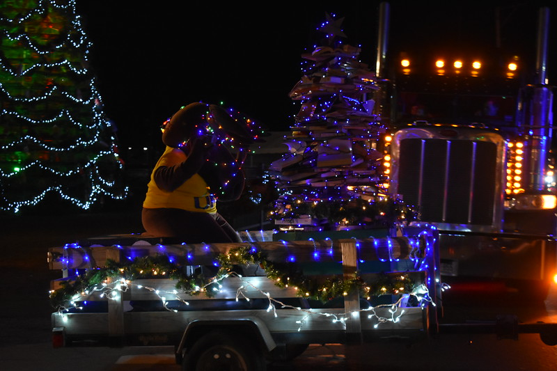 UMA's mascot Augustus the Moose rides a holiday float in the Rockland Festival of Lights Parade.