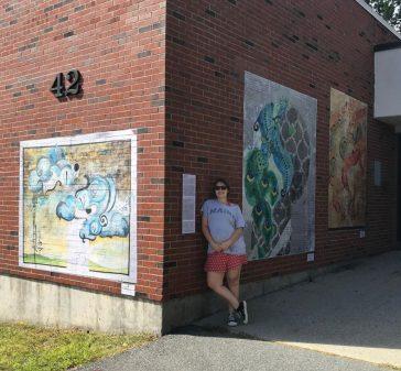 Murals on outdoor brick wall